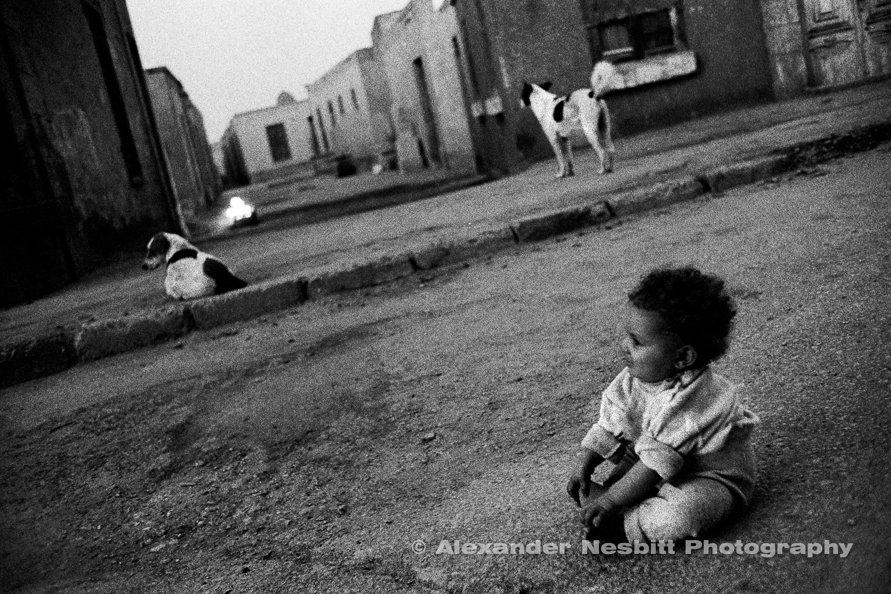 City of the Dead, Cairo  - A baby plays on the quiet streets of the cemetery.  With lost of open space and little traffic it often presents a desirable alternative to other Cairo neighborhoods.