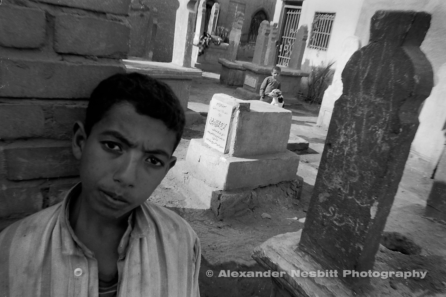 Some 1/2 million people inhabit the massive, 7km long cemetery that borders the easter side of Cairo.  They form a complete civilization living on top of, within, and around the graves of their ancestors.