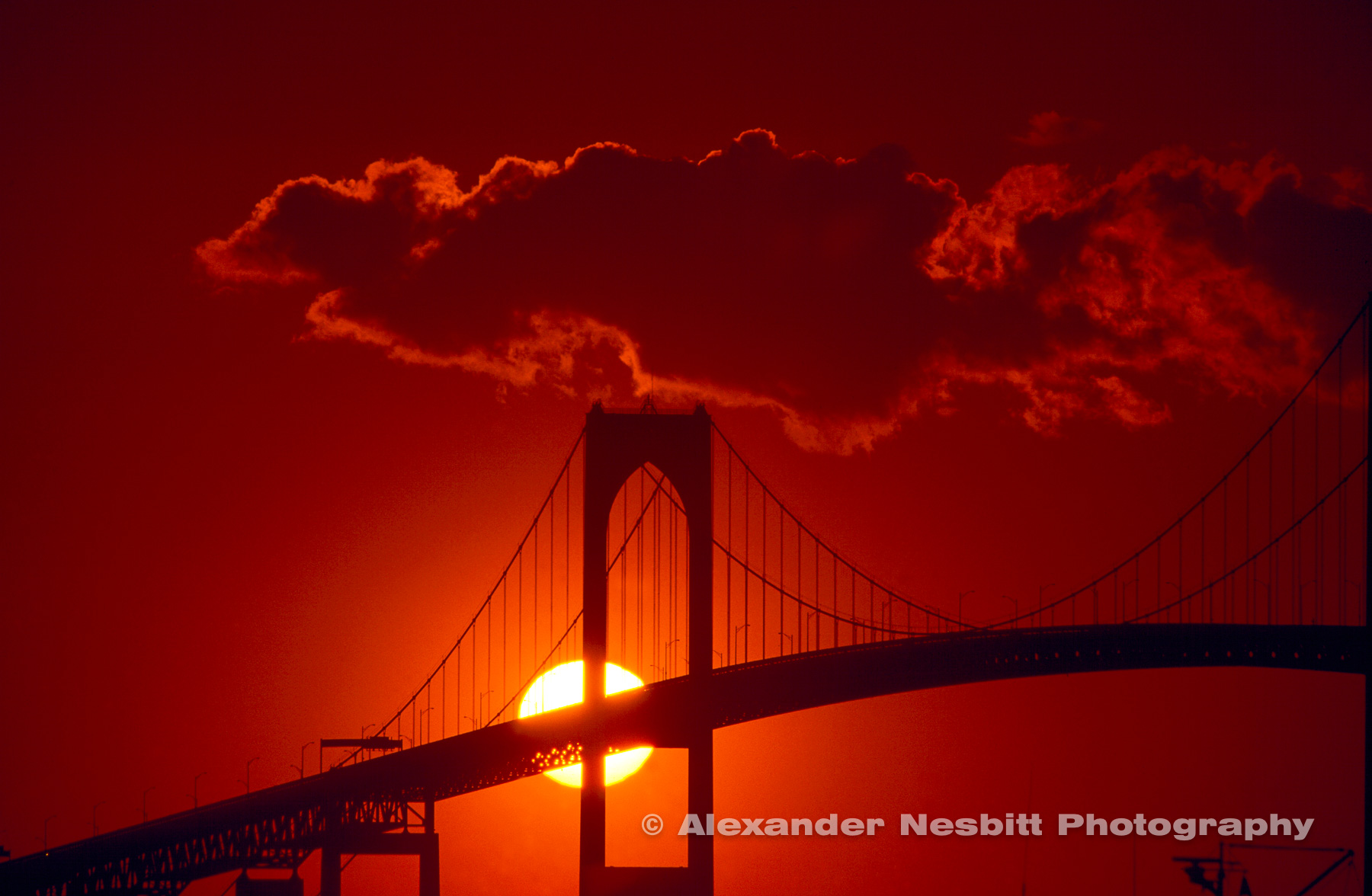 USA, Newport, RI - Sunset behind pilings of Newport Bridge in Newport Ri.