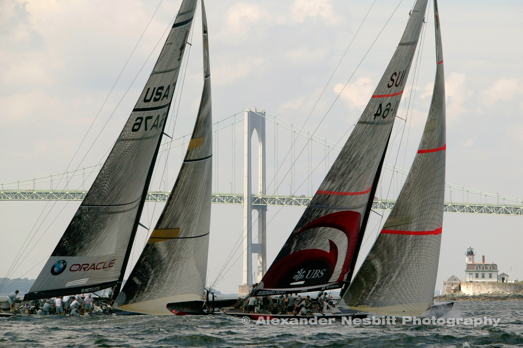 USA, Newport, RI 2004 - America's cup boats returned to Newport for the first time since the cup left in 1983.  The race for the UBS trophy was the first course close enough to land for spectators to watch the drama right in front of the Newport Bridge.