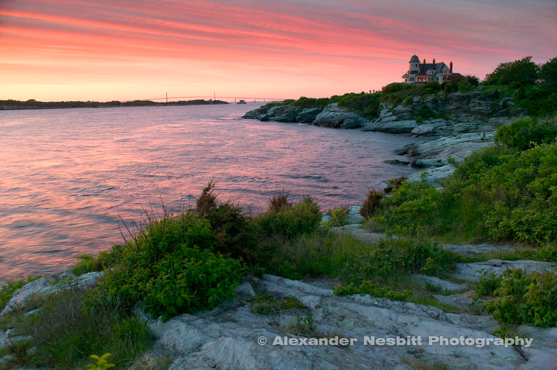 USA, Newport, RI - A gentle pink sunset at Castle Hill Inn and Resort with the view north up the east passage of Narragansett bay to the Newport Bridge. Viewed from near the lighthouse