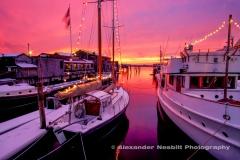 Usa, Newport, RI - A magenta winter sunset over narrangsett bay in the snowy christmas season.