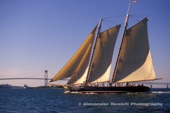 Replica of the Schooner America sails past the Newport, Bridge. Newport, RI. The original America as the first winner of the America's cup.