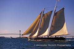 Replica of the Schooner America sails past the Newport, Bridge. Newport, RI. The original America as the first winner of the America's cup.