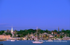 A classic dusk view from years gone by of Newport RI harbor and skyline see from accross the harbor on Goat Island