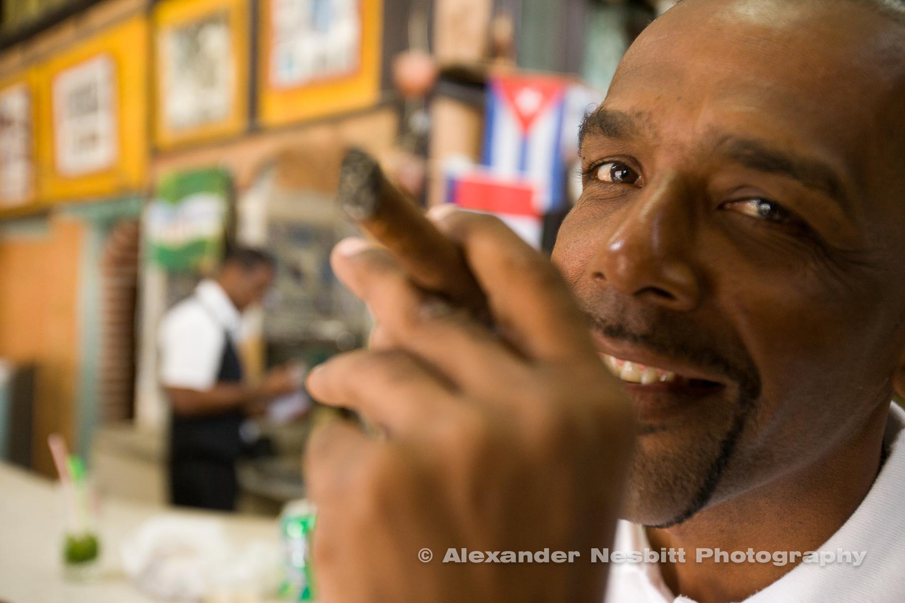 Havana, Cuba - Cuban Man with his cigar in a close up, low depth of field portrait in a bar in old Havana