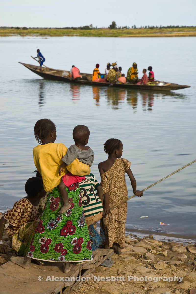 A Family waits for a lift across the Niger inear Timbuctou, Mali
