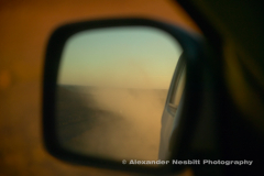 Dusty track in rearview mirror, Namibia