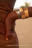 Namibia, 2004 - Hand made bracelets adorn the arm of a Himba woman, Kaokoland, northwestern Namibia.