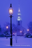 USA, Newport, RI -Trinity Church in a winter snow fall with gas lamps in Queen Anne's Square before the redesign of the park.