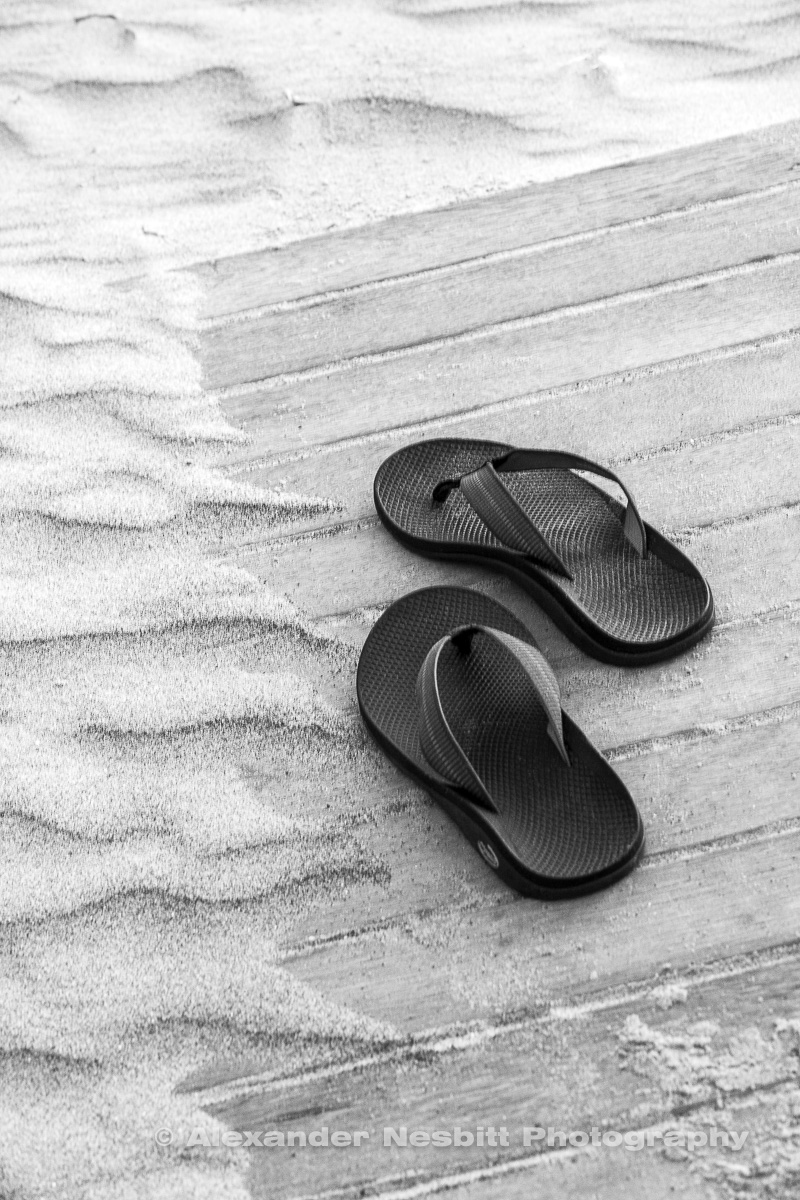 Flip flops on beach board walk
