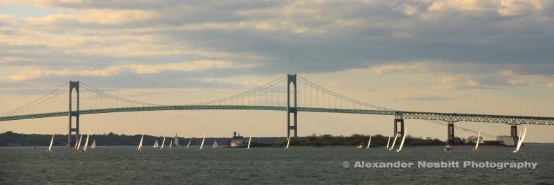 Yachts race toward the Newport Bridge