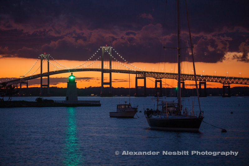 Dramatic clouds over a Newport Bridge Sunset