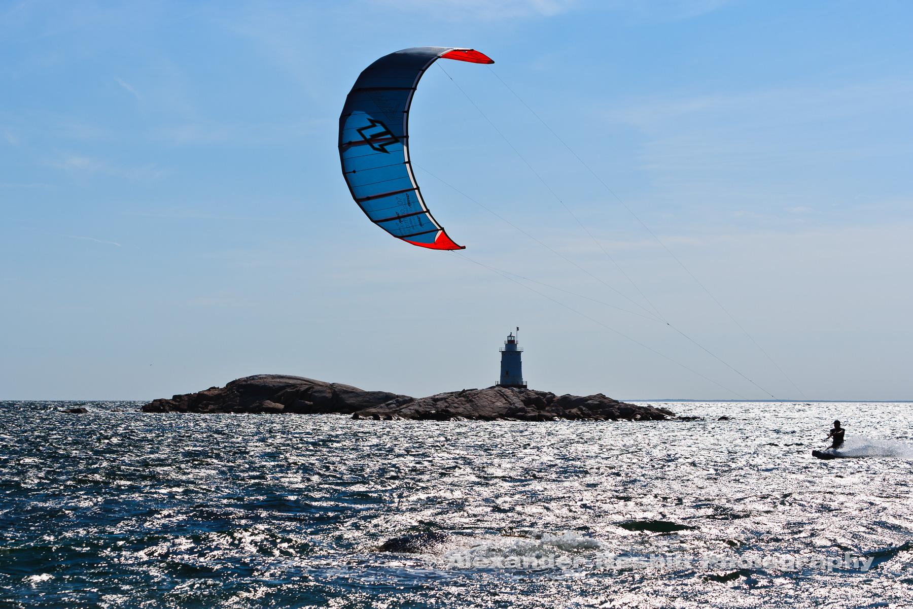 Kiteboarding past the Sakonet point light house,