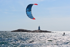 Kiteboarding past the Sakonet point light house, Little Compton RI