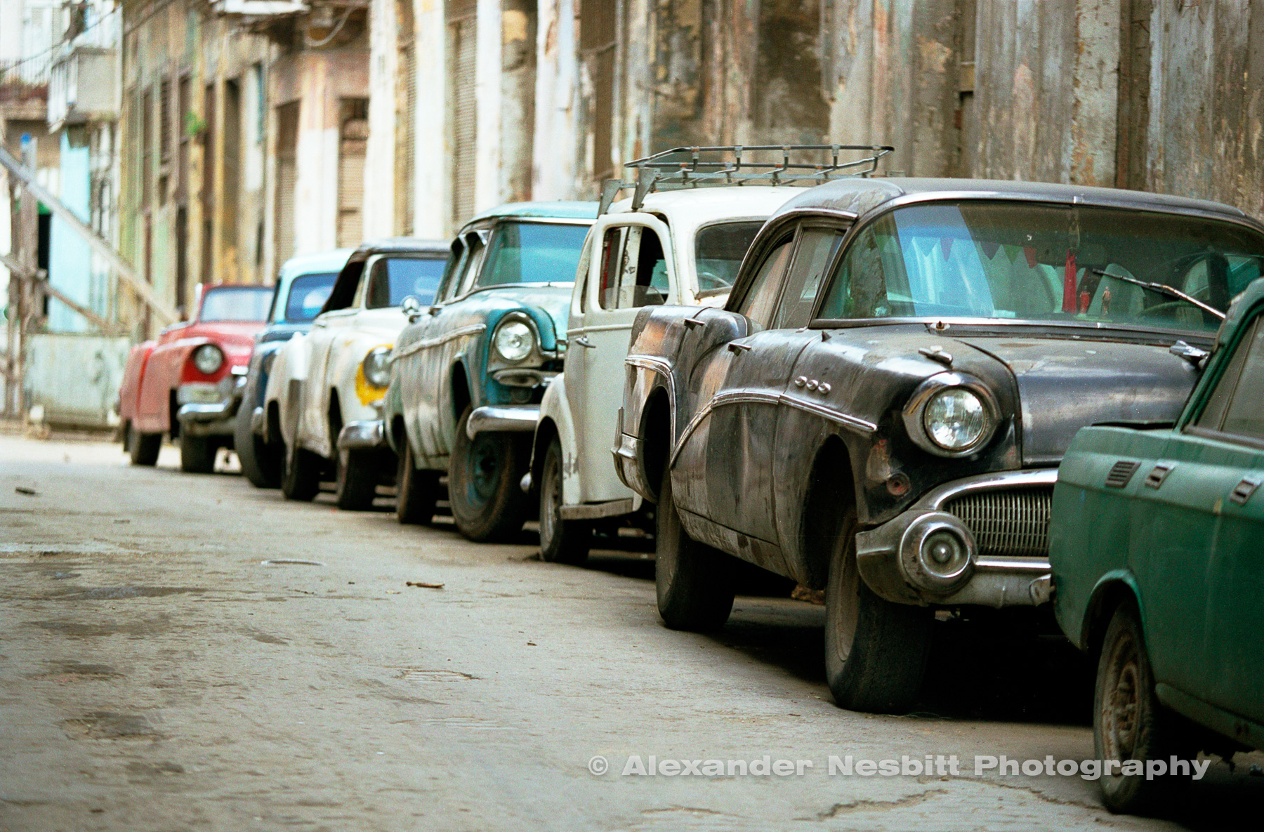 Cuba, Havana 1997- Line of old cars parked in Havana
