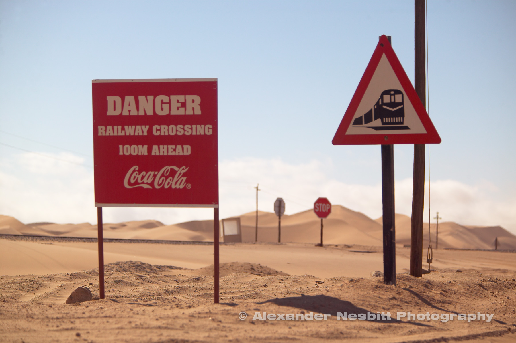 Namibia, 2004 - CocaCola sponsored signs in around the popular dune area of Walvis Bay make a great example of the subtle influence of what many call Cocacolonialism.