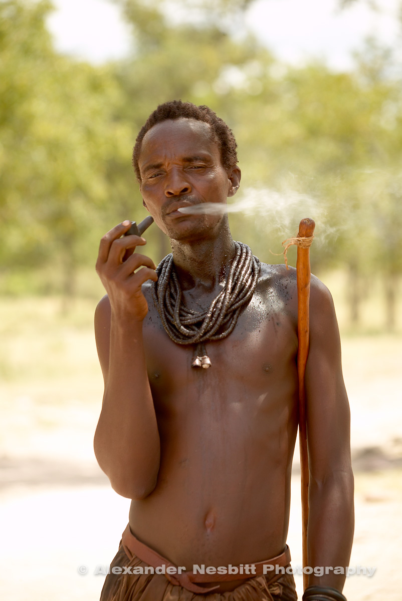 Namibia, 2004 - Smoking Himba man on the road from Epupa falls.
