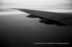 Moody view of 747 airplane wing out the window.