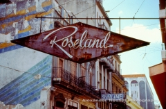 Cuba, Havana 1997- Rusted and faded nineteen-fifties department store sign for the Roseland store in downtown Havana.  In 1997 the sign hung dramatically over an intersection. By 2009 a few dangling wires remained.
