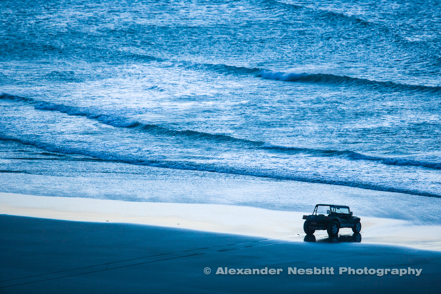 Dune buggy and waves