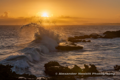 Wave crashes through the sunset, Guadeloupe